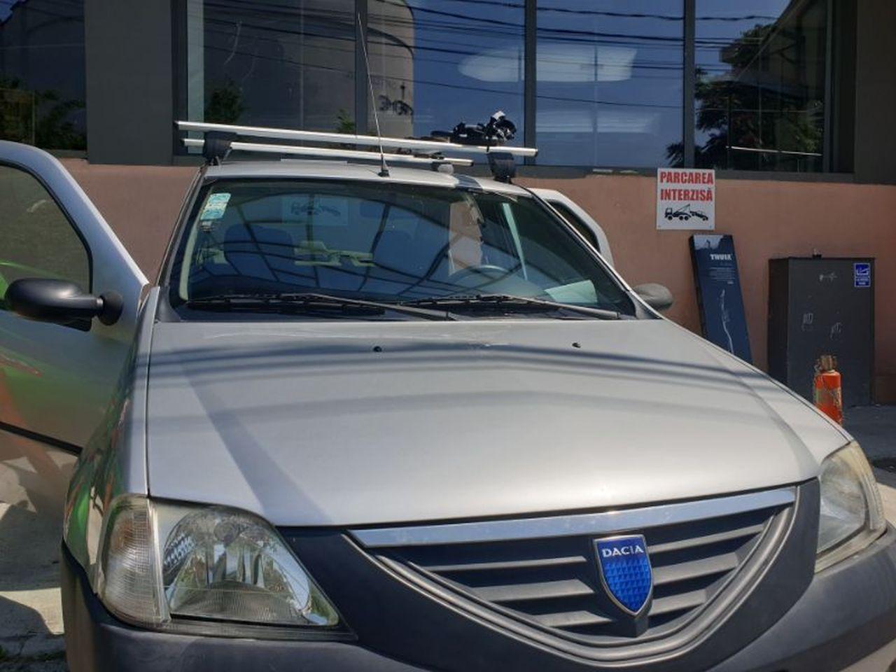 Dacia Logan bare transversale Menabo Delta si suport bicicleta Thule FreeRide