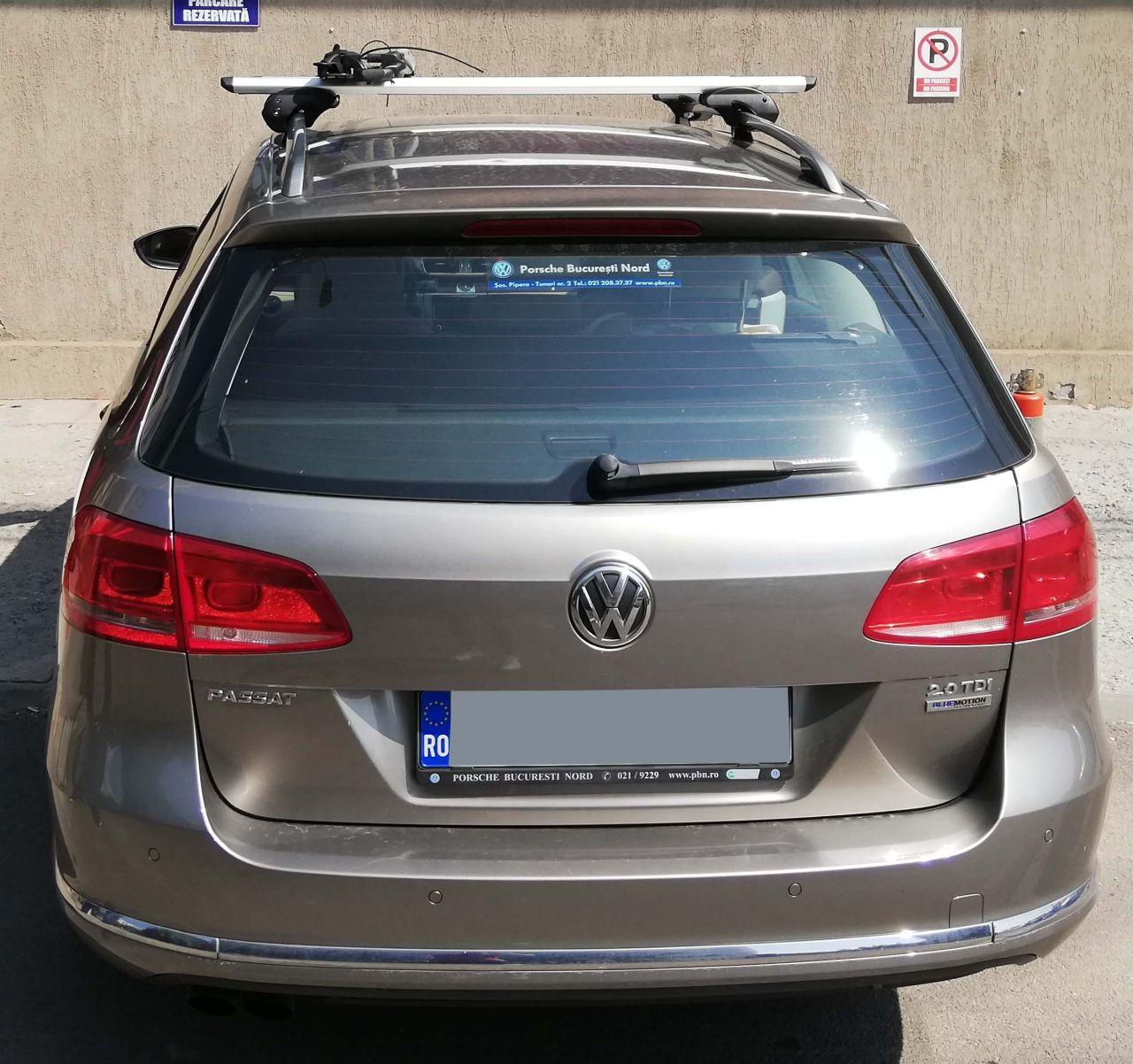 Volkswagen Passat bare transversale Menabo Sherman si suport bicicleta Thule Freeride